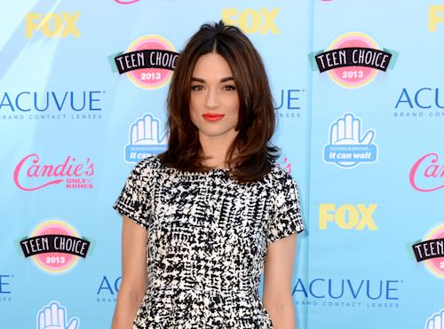 "FILE - This Aug. 11, 2013, file photo, shows actress Crystal Reed from the MTV series ""Teen Wolf,"" at the Teen Choice Awards in Los Angeles. MTV is launching a special website for angst-ridden fans of its ""Teen Wolf"" series to collectively mourn the sudden death of one of the show's main characters in the episode that aired Monday, March 17, 2014. Immediately after the third season's penultimate episode ended at 11 p.m. ET, MTV had the site TeenWolfMemorial.com ready to offer solace for people upset that the character Allison Argent, played by Reed, died. (Photo by Jordan Strauss/Invision/AP, File)"
