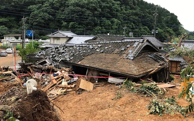 A collapsed house following a landslide caused by torrential rain in Ashikita, Kumamoto prefecture - STR/AFP