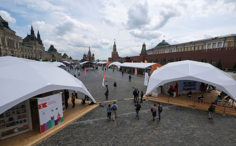 People attend the annual Red Square Book Fair in central Moscow