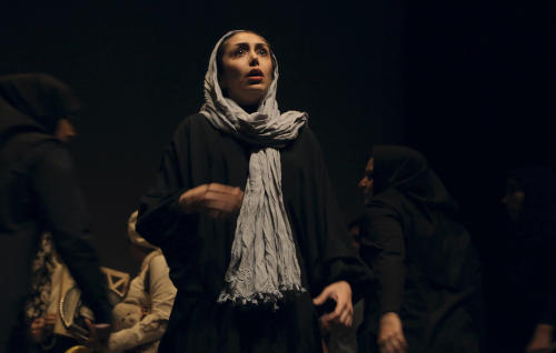 """In this undated photo, Iranian actress Sami Moslemi performs a scene from """"The Blue Feeling of Death,'' in Arasbaran Cultural Center in Tehran, Iran. The production, translated from Farsi as """"The Blue Feeling of Death,"""" opened last month as a showcase of activist art against Iran's legal codes that allow death sentences for children — who then wait until their 18th birthday for possible execution. Opening night came even as Iranian officials tightened controls on the social media and other forms of political opposition before presidential elections, whose centrist winner, Hasan Rouhani, has brought hope of reversing some of the crackdowns. (AP Photo/Hadi Shabani)"""