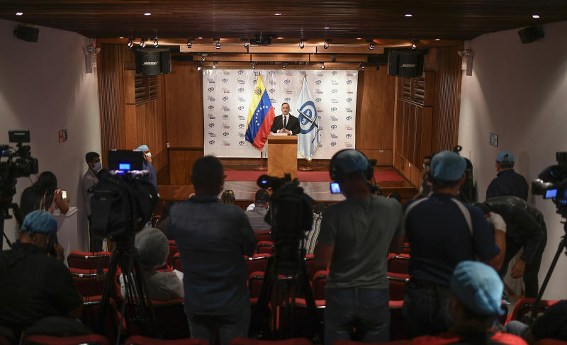 Venezuela's Attorney General Tarek William Saab gives a press conference regarding what the government calls a failed attack over the weekend aimed at overthrowing President Nicolás Maduro in Caracas, Venezuela, Monday, May 4, 2020. The government's claims that it had foiled a beach landing Sunday triggered a frenzy of confusing claims and counterclaims about the alleged plot. (AP Photo/Matias Delacroix)