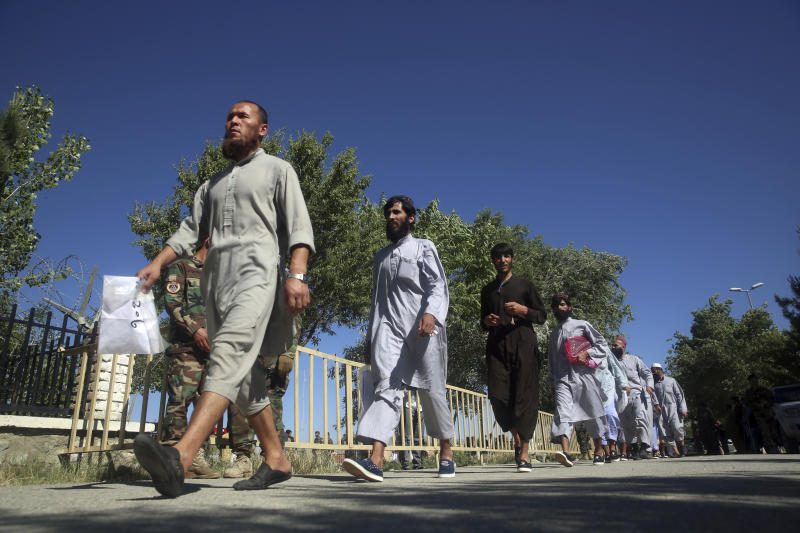 Afghan Taliban prisoners are released from Bagram Prison in Parwan province, Afghanistan, Tuesday, May 26, 2020.The Afghan government freed hundreds of prisoners, its single largest prisoner release since the U.S. and the Taliban signed a peace deal earlier this year that spells out an exchange of detainees between the warring sides. (AP Photo/ Rahmat Gul)