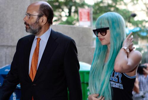 """FILE - In this Tuesday, July 9, 2013 file photo, Amanda Bynes, accompanied by attorney Gerald Shargel, arrives for a court appearance in New York on allegations that she chucked a marijuana bong out the window of her 36th-floor Manhattan apartment. A judge has granted Amanda Bynes' mother a conservatorship over the former child actress. Ventura County Judge Glen Reiser ruled Friday, Aug. 9, that Richard and Lynn Bynes should be allowed to limited control their daughter's personal affairs, including medical treatment.The former star of Nickelodeon shows """"All That"""" and her own variety series has been in a psychiatric hospital in California since last month. (AP Photo/Bethan McKernan, File)"""