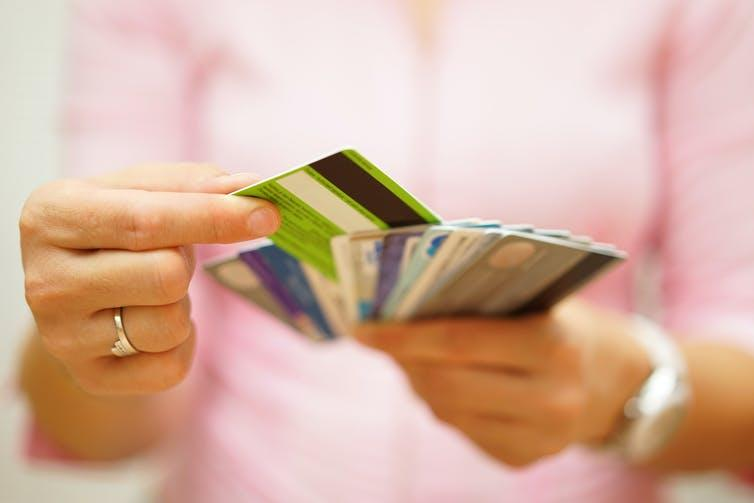 Woman choosing between different credit cards.