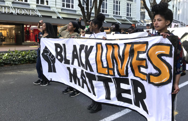 Protesters chant during a Black Lives Matter protest in central Wellington, New Zealand, Sunday June, 14, 2020. Thousands of New Zealanders turned out to protests Sunday in Auckland and Wellington. In Auckland, the protest began at the central Aotea Square and ended at the U.S. consulate, where protesters took a knee and observed a minute's silence to commemorate George Floyd, who died at the hands of Minneapolis police last month. (Jason Walls/NZME via AP)