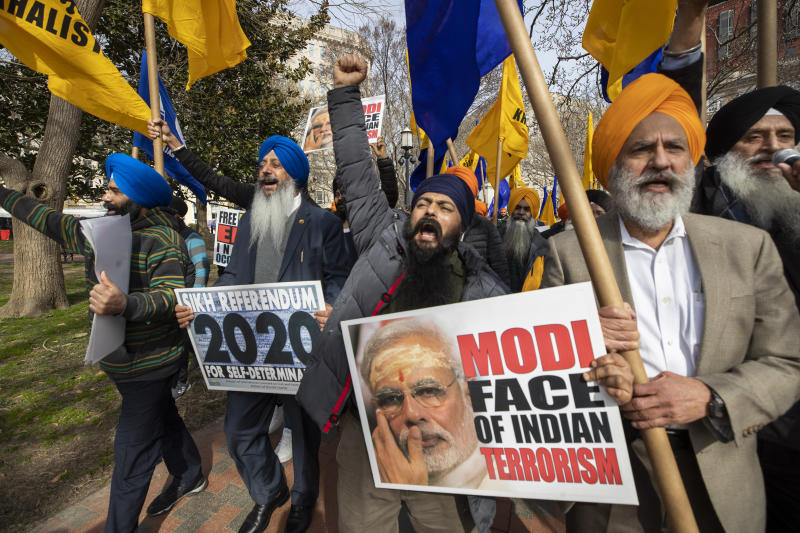Bhupinder Singh, center, joins other Indian Sikhs in a march near the White House, Tuesday, Feb. 18, 2020, in Washington, to protest the Indian government's injustice against Sikhs in India ahead of President Donald Trump's visit to India.  (AP Photo/Manuel Balce Ceneta)
