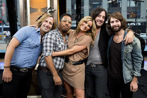 FILE - This June 12, 2012 file photo shows members of Grace Potter and the Nocturnals, from left to right, Matt Burr, Michael Libramento, Grace Potter, Scott Tournet and Benny Yurco pose for a portrait in New York. Grace Potter & The Nocturnals know a little something about summer festivals after using the circuit to build their following. Their Grand Point North Festival will be held on Sept. 13-14. (Photo by Charles Sykes/Invision/AP, file)