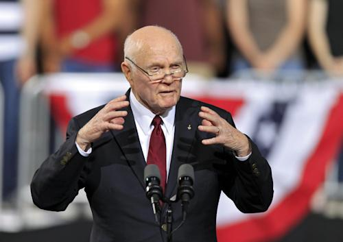 FILE - This May 5, 2012 file photo shows former astronaut and former Ohio Sen. John Glenn speaking before a campaign rally for President Barack Obama at The Ohio State University in Columbus, Ohio. Whatever their political beliefs, some artists perform an age-old ritual: warming up the crowd before a political rally, generating enthusiasm and all-important buzz for events that otherwise could be overlooked in a crowded news cycle. For politicians _ even those as well known as Obama and Republican presidential candidate, former Massachusetts Gov. Mitt Romney _ celebrity warm-up acts can provide validation by taking them out of the political realm into popular culture, said Darrell West, director of governance studies at the Brookings Institution think tank in Washington. (AP Photo/Mark Duncan, File)