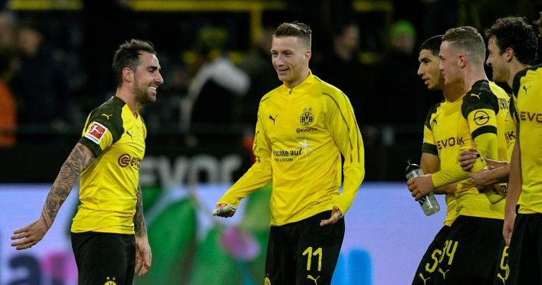 Paco Alcacer (L) and club captain Marco Reus (C) have been outstanding for current Bundesliga leaders Borussia Dortmund
