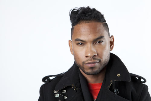"In this Friday, Jan. 4, 2013 photo, American recording artist, songwriter and producer, Miguel, poses for a portrait, in New York. Miguel is nominated for five Grammy Awards, including song of the year for his No. 1 R&B hit, ""Adorn,"" and best urban contemporary album for his sophomore release, ""Kaleidoscope Dream."" The Grammys air Feb. 10., 2013. (Photo by Amy Sussman/Invision/AP Images)"