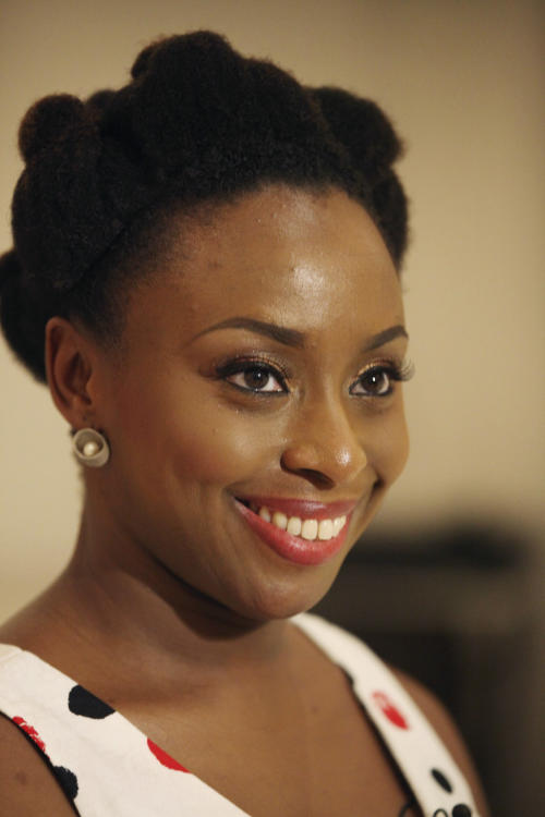 "In this photo taken, Saturday, April. 27, 2013, Chimamanda Ngozi Adichie, during an interview with Associated Press, in Lagos, Nigeria. Modern life in Lagos, Nigeria's largest city, has become almost a character itself in novelist Chimamanda Ngozi Adichie's new book, ""Americanah."" Within its pages, one catches self-acknowledged glimpses of the writer herself, who shot to fame with her previous novel, a love story set during Nigeria's civil war entitled ""Half of a Yellow Sun."" (AP Photo/Sunday Alamba)"