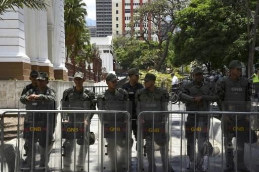 Bolivarian National Guard personnel positioned outside the Venezuela's opposition-controlled National Assembly building in Caracas
