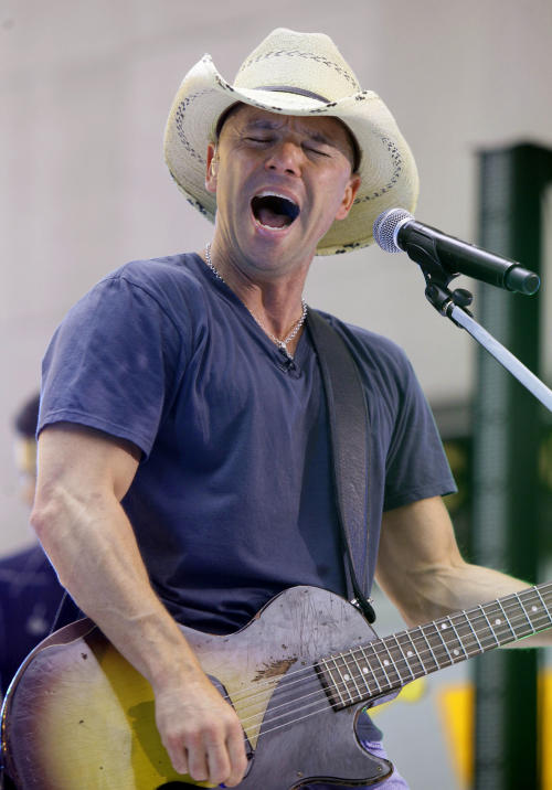 """FILE - In this June 17, 2011 file photo, singer Kenny Chesney performs on the NBC """"Today"""" television program in New York. Chesney is up for nine Academy of Country Music Awards on Sunday, April 1, 2012. (AP Photo/Richard Drew, File)"""
