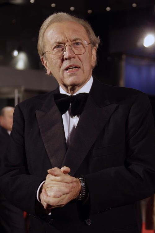 FILE - In a Wednesday, Oct. 15, 2008, file photo, British broadcaster David Frost, arrives at the world premiere of Frost/Nixon, and the opening of the London Film Festival, in central London. Veteran British broadcaster David Frost died of a heart attack on Saturday, Aug. 31, 2013, at the age of 74, (AP Photo/Joel Ryan, File)