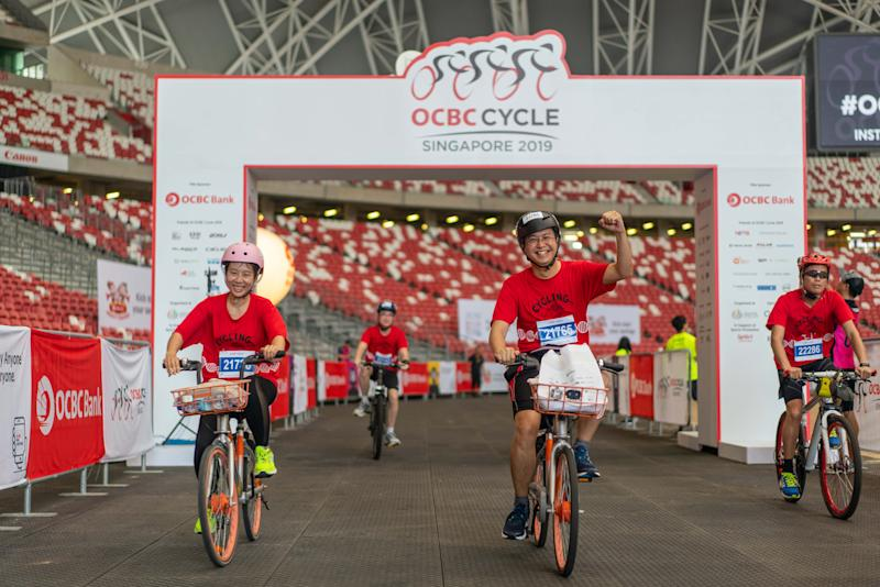 OCBC Cycle 2019 participants crossing the finish line at the National Stadium. (PHOTO: OCBC Cycle)
