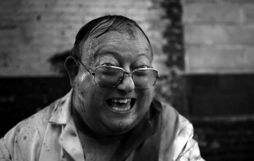 "In this image released by IFC Films, Laurence R. Harvey is shown in a scene from ""The Human Centipede 2."" (AP Photo/IFC Films)"