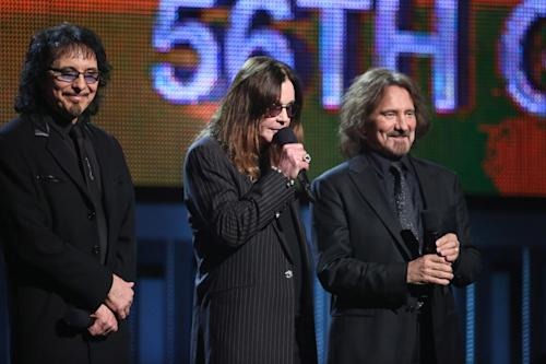 Tony Iommi, from left, Ozzy Osbourne and Geezer Butler speak on stage at the 56th annual Grammy Awards at Staples Center on Sunday, Jan. 26, 2014, in Los Angeles. (Photo by Matt Sayles/Invision/AP)