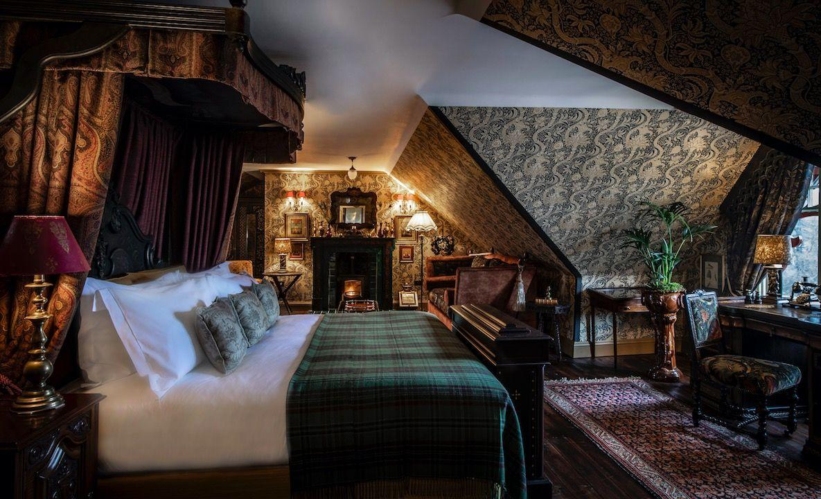 "<p>Rolltop baths, clashing prints and bonkers murals makes this eclectic pile, set in Scotland's Cairngorms, feel more achingly cool member's club than your gran's living room. Plus the guests are as fancy as the sexy décor – Judi Dench has been spotted taking selfies in the hotel's library. </p><p>Loved up couples can be found sipping the unpronounceable Mousquetaire Assis, a cocktail designed for sharing which comes served in a huge glass contraption with taps. Like a goldfish bowl for adults, it's a lethal but delicious combination of homemade absinthe, cherry liqueur and gin. Any cocktail-induced cobwebs can be blown away with a romantic walk – the scenery is Game of Thrones level stunning, with waterfalls, woods and deep, rocky gorges nearby. </p><p><strong><strong><a class=""body-btn-link"" href=""https://thefifearms.com/gclid=EAIaIQobChMI4_CD7M786wIVieh3Ch1imwTtEAAYAiAAEgKRsvD_BwE"" target=""_blank"">BOOK NOW</a> </strong>Rooms from £220pn including breakfast</strong></p>"