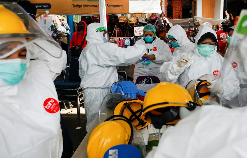 Indonesia's coronavirus infections top 14,000 - official