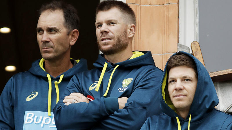 Justin Langer, David Warner and Tim Paine look on as rain delays the start of play. (Photo by Ryan Pierse/Getty Images)