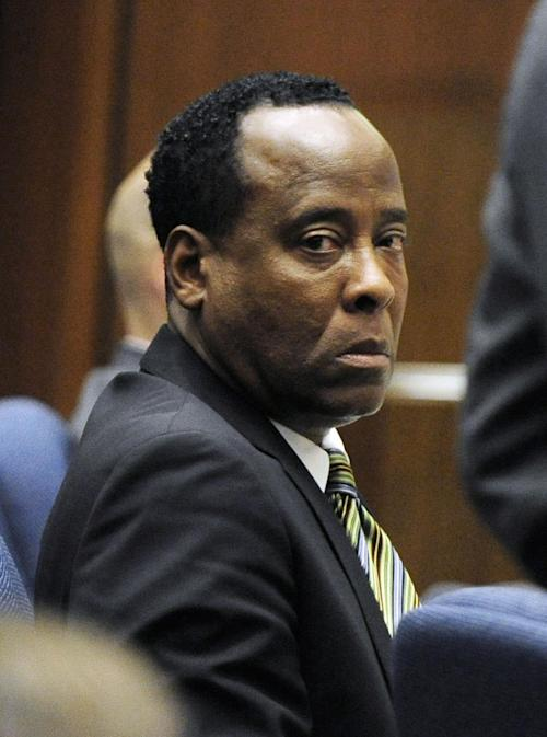 """FILE - In this Oct. 27, 2011 file photo, Dr. Conrad Murray listens to testimony by Dr. Paul White, an anesthesiologist and propofol expert, during Dr. Conrad Murray's involuntary manslaughter trial in Los Angeles. The attorney who drafted the agreement for Michael Jackson's doctor to work on the singer's """"This Is It"""" shows told a Los Angeles jury on Tuesday, Aug. 6, 2013, that the physician told her his clinics earned more than $1 million a month and she told the CEO of the concert promoter AEG Live LLC that he appeared to be successful. Kathy Jorrie's testimony came in a negligence lawsuit filed by Jackson's mother against AEG Live, claiming the company failed to adequately investigate Dr. Conrad Murray, who was convicted of giving the singer a fatal dose of anesthesia in June 2009. (AP Photo/Paul Buck, Pool, File)"""
