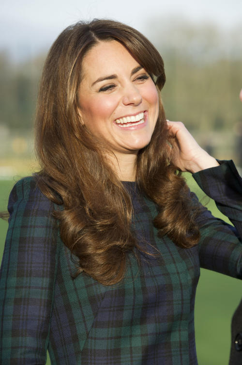 FILE - Kate, the Duchess of Cambridge seen during her visit to St. Andrew's School, where she attended school, in Pangbourne, England, in this file photo dated Friday, Nov. 30, 2012. The Duke and Duchess of Cambridge are very pleased to announce that the Duchess of Cambridge is expecting a baby, St James's Palace officially announced Monday Dec. 3, 2012. (AP Photo/Arthur Edwards, File)