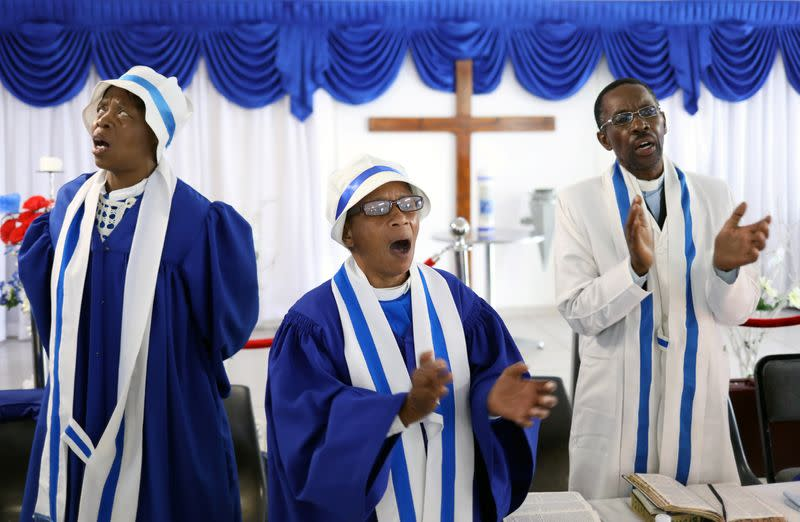 Faithful worship during a church service amid concerns about the spread of coronavirus disease (COVID-19) at the Apostolic Christian Church in Kagiso