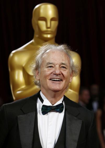 Actor Bill Murray smiles as he arrives at the 86th Academy Awards in Hollywood
