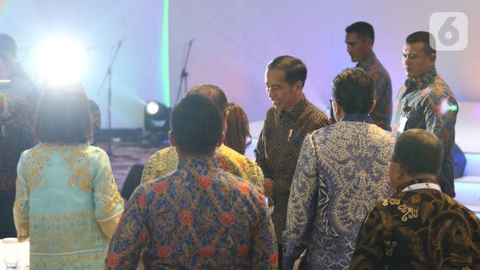 Presiden Joko Widodo tiba dalam acara Indonesia Banking Expo (IBEX) 2019 di Jakarta, Rabu (26/11/2019). IBEX 2019 untuk memberi rekomendasi terkait konsolidasi sektor keuangan dan bisnis fintech guna menciptakan ekosistem keuangan yang kuat, efektif dan efisien. (Liputan6.com/Angga Yuniar)