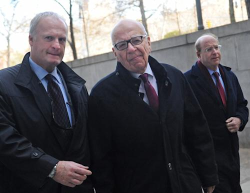 "Rupert Murdoch ,center, arrives at State Supreme court, Wednesday, Nov. 20, 2013, in New York. Murdoch and his soon-to-be-ex-wife said they were parting with ""mutual respect"" Wednesday after telling a judge they had reached a divorce deal. (AP Photo/ Louis Lanzano)"