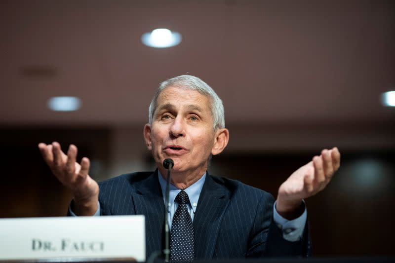 As Trump holds rally, Fauci urges masks, avoiding mass gatherings