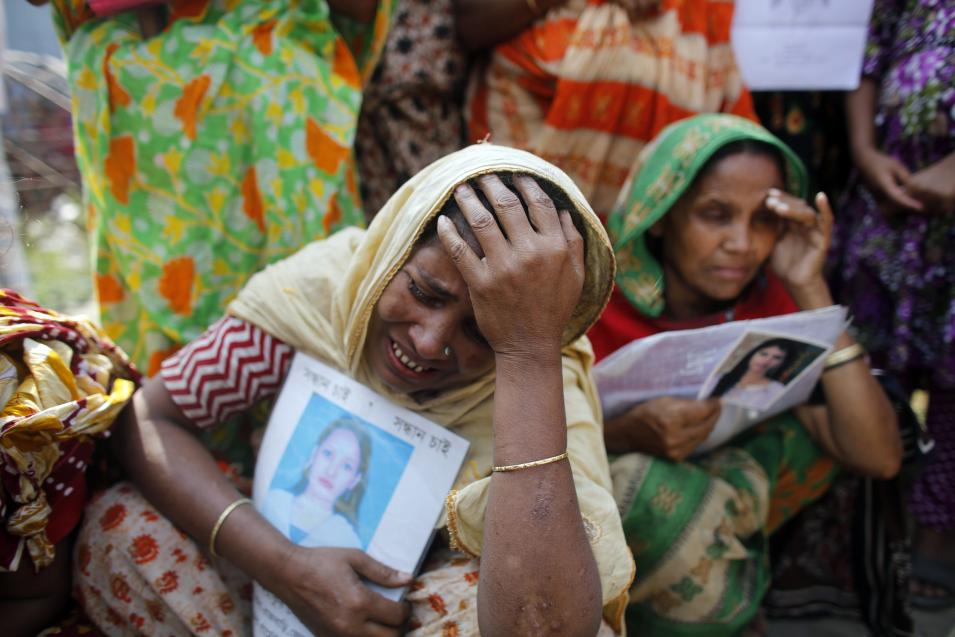 A relative of a garment worker, who is still missing after the Rana Plaza building collapse, cries during a protest in front of the site in Savar