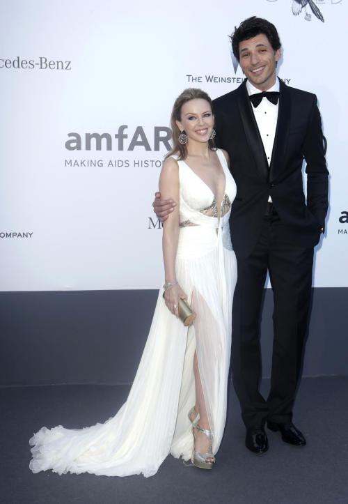 Singer Kylie Monigue and Andres Velencoso arrive at amfAR Cinema Against AIDS benefit at the Hotel du Cap-Eden-Roc, during the 66th international film festival, in Cap d'Antibes, southern France, Thursday, May 23, 2013. (Photo by Joel Ryan/Invision/AP)