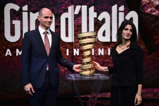 Israel's ambassador to Italy Ofer Sachs and Rome mayor Virginia Raggi pose with the trophy of the Giro d'Italia