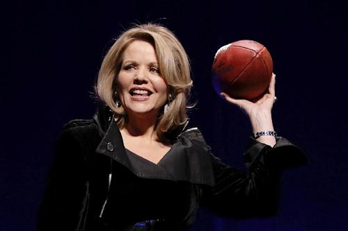 Opera singer Renee Fleming who will sing the National Anthem before the NFL Super Bowl XLVIII football game holds the game ball during a press conference Thursday, Jan. 30, 2014, in New York. (AP Photo)