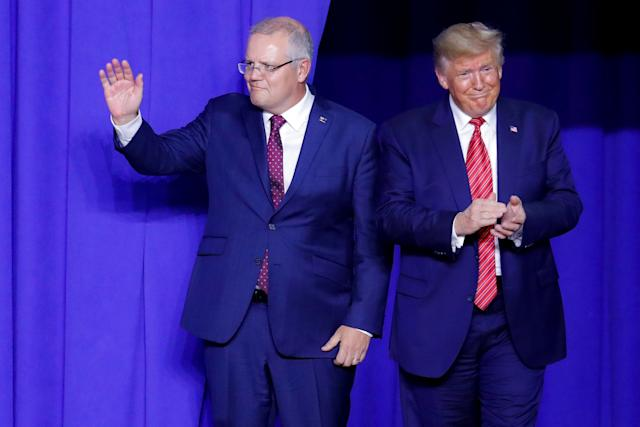 President Donald Trump, right, and Australian Prime Minister Scott Morrison take the stage as they mark the opening of an Australian-owned Pratt Industries plant on Sept. 22.  (Photo: AP Photo/John Minchillo)