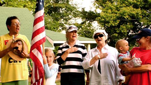 "In this July 4, 2008 image from video provided by David Wilson, Bill Lennon, left, and his sisters Diane, center left, Peggy, center right, and Janet, right, who were a household name to millions during their heyday on the Lawrence Welk show, sing the The Star-Spangled Banner with unidentified family members on the family ranch near Branson, Mo. The Lennon's are one of four families living in the Branson area that documentary filmmakers David Wilson and A.J. Schnack followed over five years to produce ""We Always Lie to Strangers,"" a middle America, flag-waving, family-friendly celebration of musical variety shows and early-bird dinner specials. The documentary will be distributed nationally in 2014. (AP Photo/Courtesy David Wilson)"