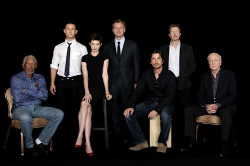 "FILE - In this July 7, 2012 file photo, from left, actor Morgan Freeman, actor Joseph Gordon-Levitt, actress Anne Hathaway, director Christopher Nolan, actor Christian Bale, actor Gary Oldman, and actor Michael Caine, from the upcoming film ""The Dark Knight Rises,"" pose during a photo shoot in Beverly Hills, Calif. In Nolan's ""Batman"" trilogy, Caine and Freeman both play paternal figures of sorts to wealthy orphan Bruce Wayne (Christian Bale), whose anger over his parents' murder is the seed that turns him into the masked protector of Gotham City. The film released in theaters on July 20. (Photo by Matt Sayles/Invision/AP)"