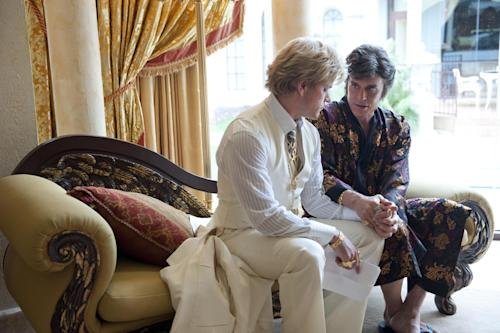 """This film image released by HBO shows Michael Douglas, right, as Liberace, and Matt Damon, as Scott Thorson in a scene from """"Behind the Candalabra,"""" a film being shown at the Cannes Film Festival. (AP Photo/HBO, Claudette Barius)"""