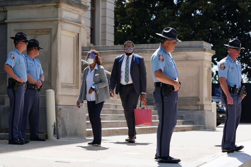 Georgia State Patrol officers are seen outside the Georgia State Capitol building in Atlanta