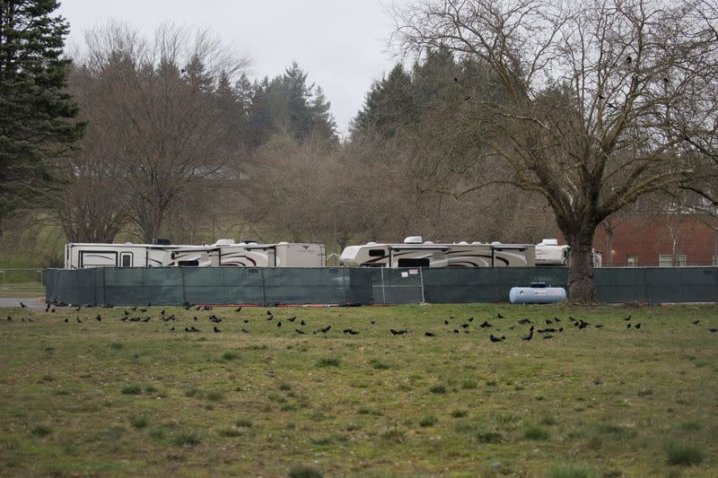 Recreational vehicles (RVs) are seen parked in a earmarked quarantine site for healthy people potentially exposed to novel coronavirus, behind Washington State Public Health Laboratories in Shoreline, north of Seattle