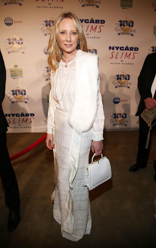 Anne Heche arrives at the 24th Night of 100 Stars Oscars Viewing Gala at The Beverly Hills Hotel on Sunday, March 2, 2014 in Beverly Hills, Calif. (Photo by Annie I. Bang /Invision/AP)