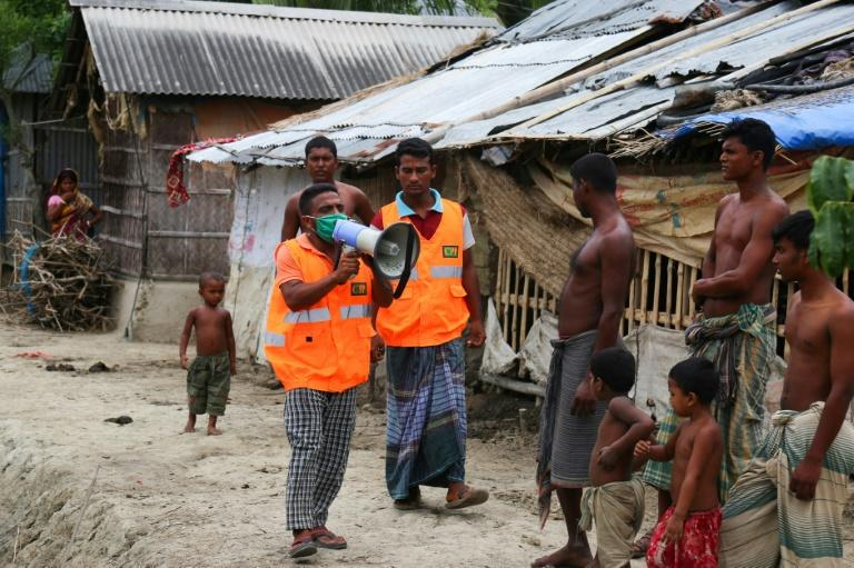 A volunteer urges residents to evacuate to shelters on May 19 ahead of the expected landfall of Super Cyclone Amphan in Khulna, Bangladesh