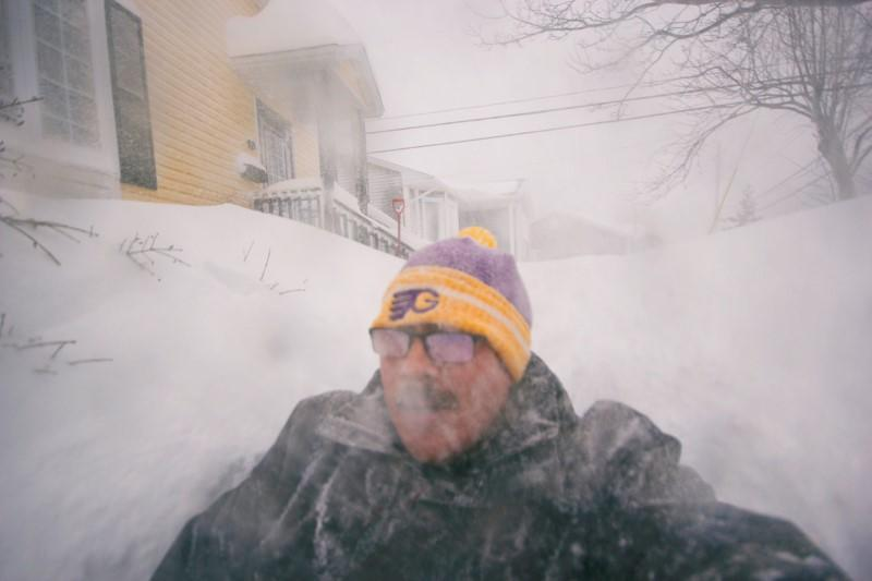 A man is pictured in a snowy street in St. John's, Newfoundland and Labrador