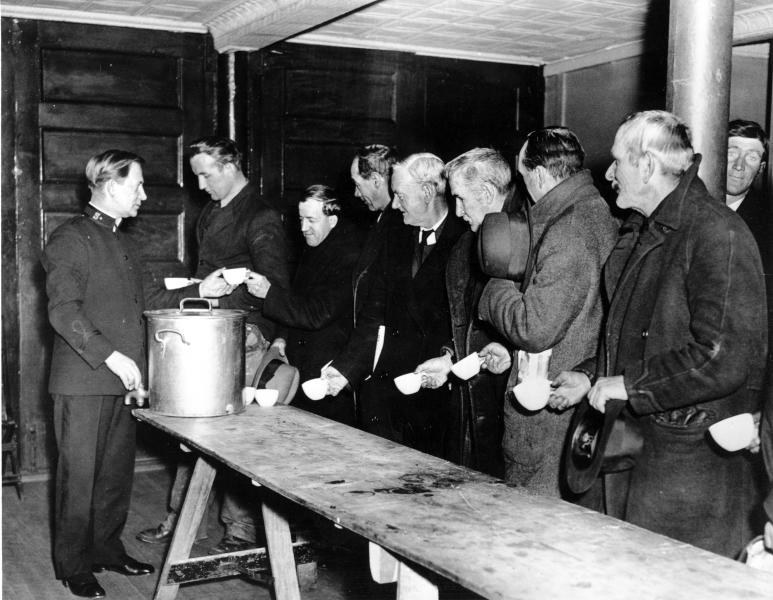 A Salvation Army relief worker tends to a line at a local soup kitchen during the Great Depression. Nearly a century later, the U.S. economy is all but shut down, and layoffs are soaring at small businesses and major industries. A devastating global recession looks inevitable. Deepening the threat, a global oil price war has erupted. Some economists foresee an economic downturn to rival the Depression. (AP Photo)