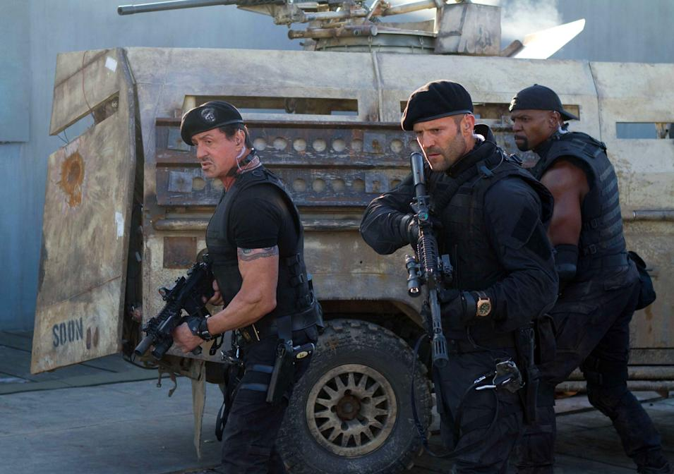 "This film image released by Lionsgate shows, from left, Sylvester Stallone, Jason Statham and Terry Crews in a scene from ""The Expendables 2."" (AP Photo/Lionsgate-Millennium Films, Frank Masi)"