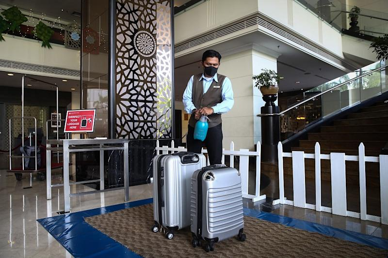 A hotel staff disinfects guests' luggage at the lobby of the Concorde Hotel in Shah Alam June 9, 2020. — Picture by Yusof Mat Isa