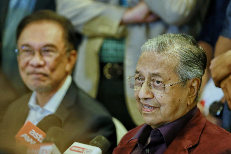Datuk Seri Anwar Ibrahim and Tun Dr Mahathir Mohamad are seen during a press conference after the Pakatan Harapan President Council Meeting at Yayasan Perdana Foundation February 21, 2020. — Picture by Ahmad Zamzahuri