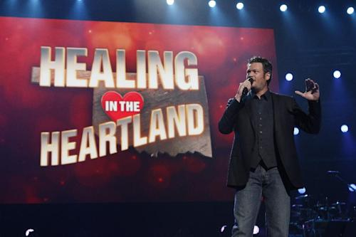 This image released by NBC Universal shows country singer Blake Shelton during the Healing in the Heartland: Relief Benefit Concert at the Chesapeake Energy Arena in Oklahoma City, Okla., Wednesday, May 29,2013. Funds raised by the benefit will go to the United Way of Central Oklahoma, for recovery efforts for those affected by the May 20 tornado. (AP Photo/NBC, Trae Patton)