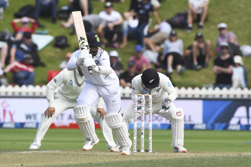 India's Cheteshwar Pujara bats against New Zealand during the first cricket test between India and New Zealand at the Basin Reserve in Wellington, New Zealand, Sunday, Feb. 23, 2020. (AP Photo/Ross Setford)